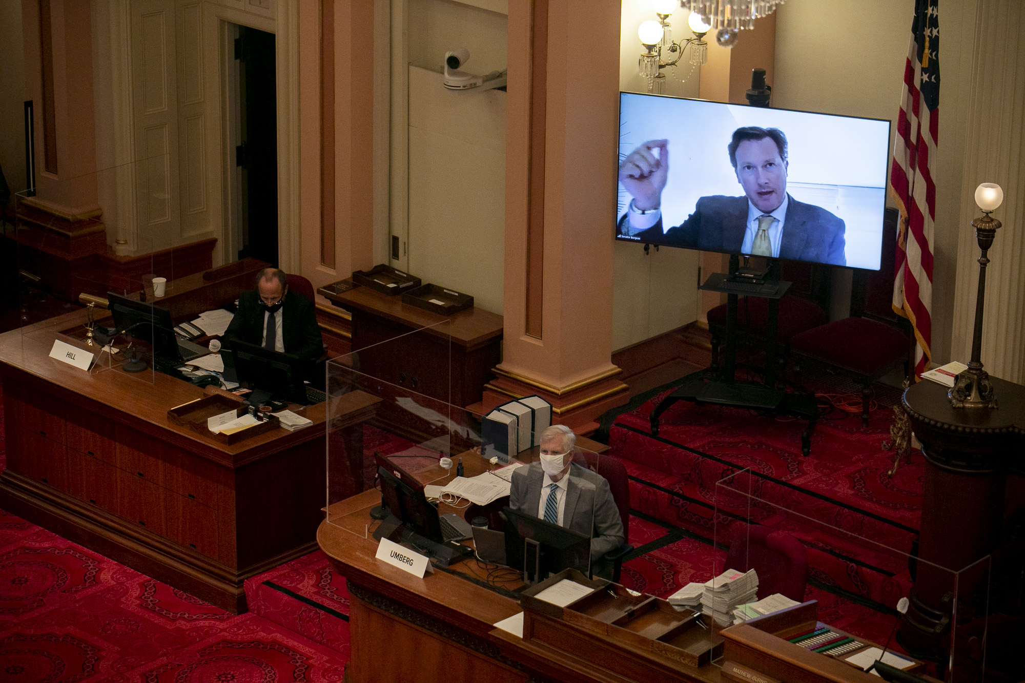 Sen. Andreas Borgeas speaks remotely about tattoo artists from a monitor during the debate on contract worker exemptions on Aug. 31, 2020. Senate republicans were required to vote remotely following a positive COVID-19 test last week among the senate GOP caucus. Photo by Anne Wernikoff for CalMatters