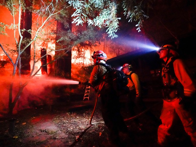 Firefighters battle the CZU August Lightning Complex Fire in the backyard of a home Aug. 21, 2020, in Boulder Creek. Photo by Marcio Jose Sanchez, AP Photo