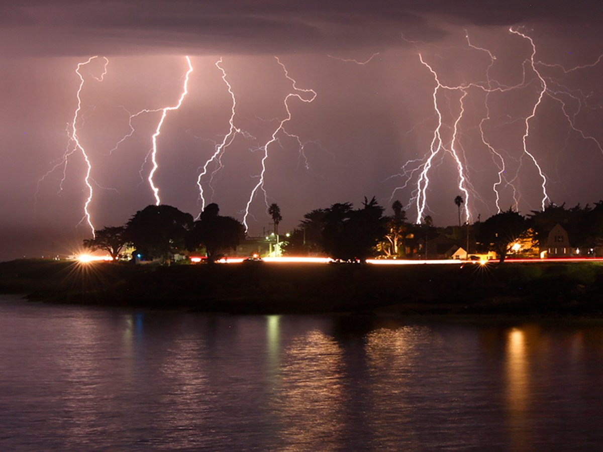 A rare lightning storm crackles over Mitchell's Cove in Santa Cruz around 3 a.m. August 16, 2020. The severe storm system rolled through the San Francisco and Monterey Bay areas early Sunday, packing a combination of dry lightning and high winds that triggered wildfires throughout the region. The National Weather Service on Sunday extended a red flag fire warning for the entire Bay Area until 11 a.m. Monday morning. Photo by Shmuel Thaler, The Santa Cruz Sentinel via AP