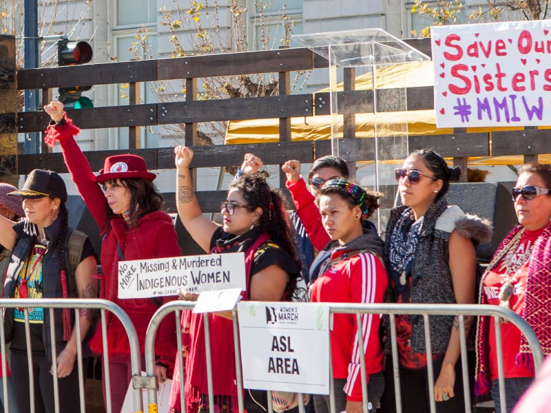 2018 Women's March San Francisco attendees raise fists and hold signs in support of missing and murdered indigenous women. Photo by Pax Ahimsa Gethen via Creative Commons (CC BY-SA 4.0)