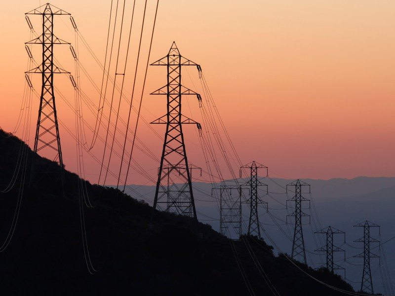 Electric Pylons in the foothills of San Gabriel mountains outside of Los Angeles. Image via iStock