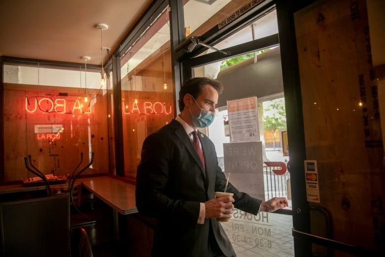 Assemblymember Kevin Kiley picks up an iced tea at La Bou in Sacramento on Aug. 28, 2020. Kiley says he has been frequenting the cafe much more since the pandemic and is fond of their avocado toast. Photo by Anne Wernikoff for CalMatters