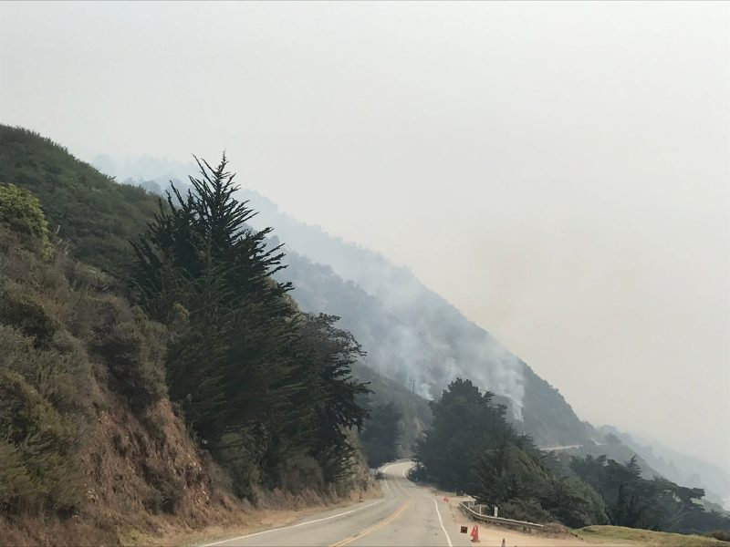 Smoke from the Dolan Fire billows skyward along Highway 1 less than a quarter mile south of the entrance to Julia Pfeiffer Burns. Aug. 22, 2020. Photo by Kate Cimini, The Salinas Californian