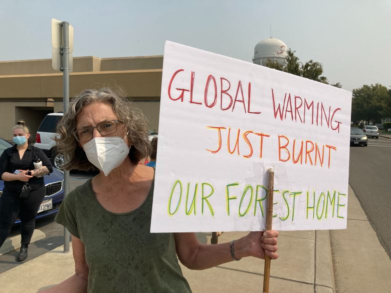 Jean Hegland, who said her home near Healdsburg burned up in one of the recent fires, turned out to protest against President Trump. Photo by Laurel Rosenhall