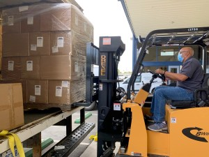 A delivery of state-supplied masks, face shields, no-touch thermometers, and hand sanitizer arrive for when Kern County schools are able to open for in-person instruction. Photo courtesy of Kern County Office of Education