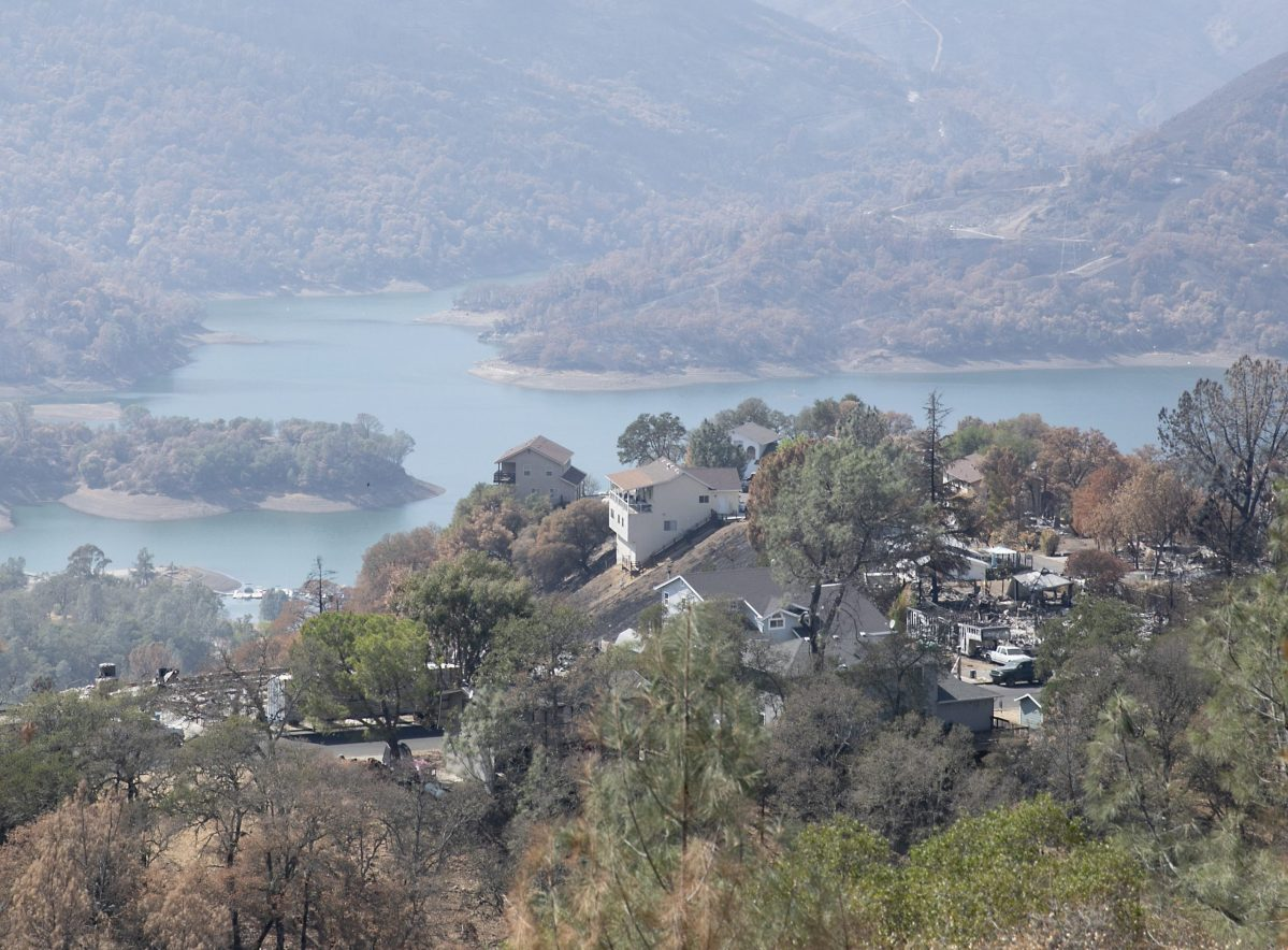 Homes destroyed by the LNU Lighting Complex Fire seen interspersed with untouched homes above Lake Berryessa, a resort area and water supply reservoir, on Sept. 21, 2020. Following the lighting complex fires in August, residents were advised not to drink or boil the tap water out of concerns for benzene and other contaminants. Photo by Anne Wernikoff for CalMatters