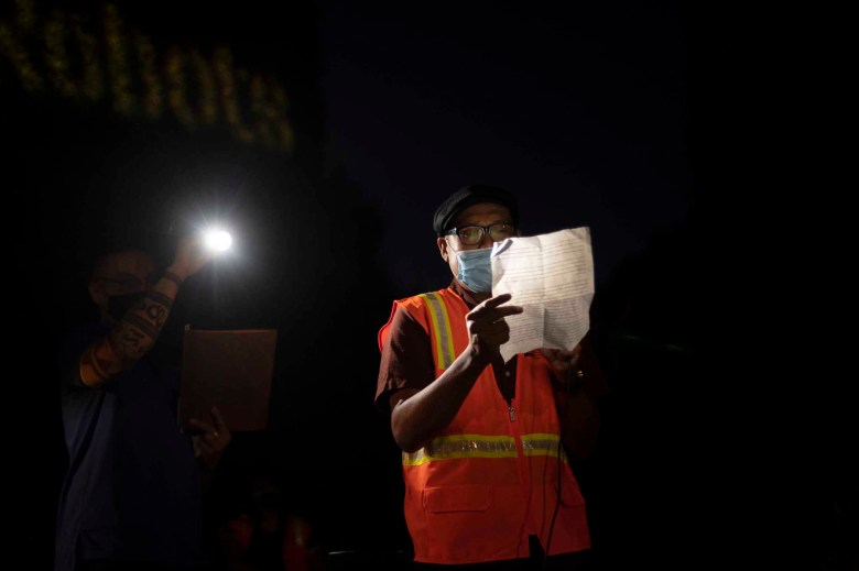 """""""Jeff Bozo is the number one virus."""" Enrico Maniago, an organizer with the Warehouse Workers Resource Center, condemns Amazon's handling of the Covid-19 pandemic during a Prime Day protest on Oct. 13, 2020. Photo by Tash Kimmell for CalMatters."""