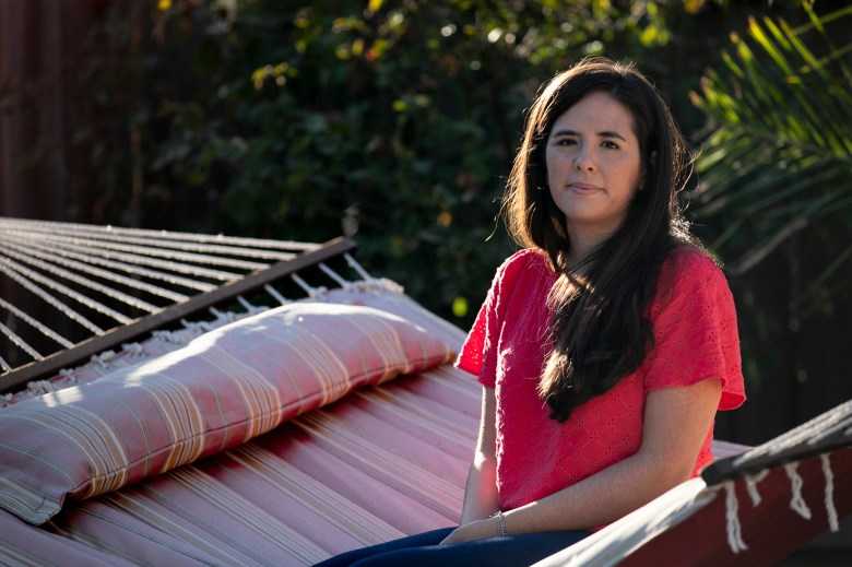 Sarah Rivas, 27, sits for a portrait in her parents' backyard in Elk Grove on Oct. 14, 2020. Rivas, a history teacher at Summit Denali, a charter school in Silicon Valley, has been living with her parents since March while teaching online in order to save money. Photo by Anne Wernikoff for CalMatters