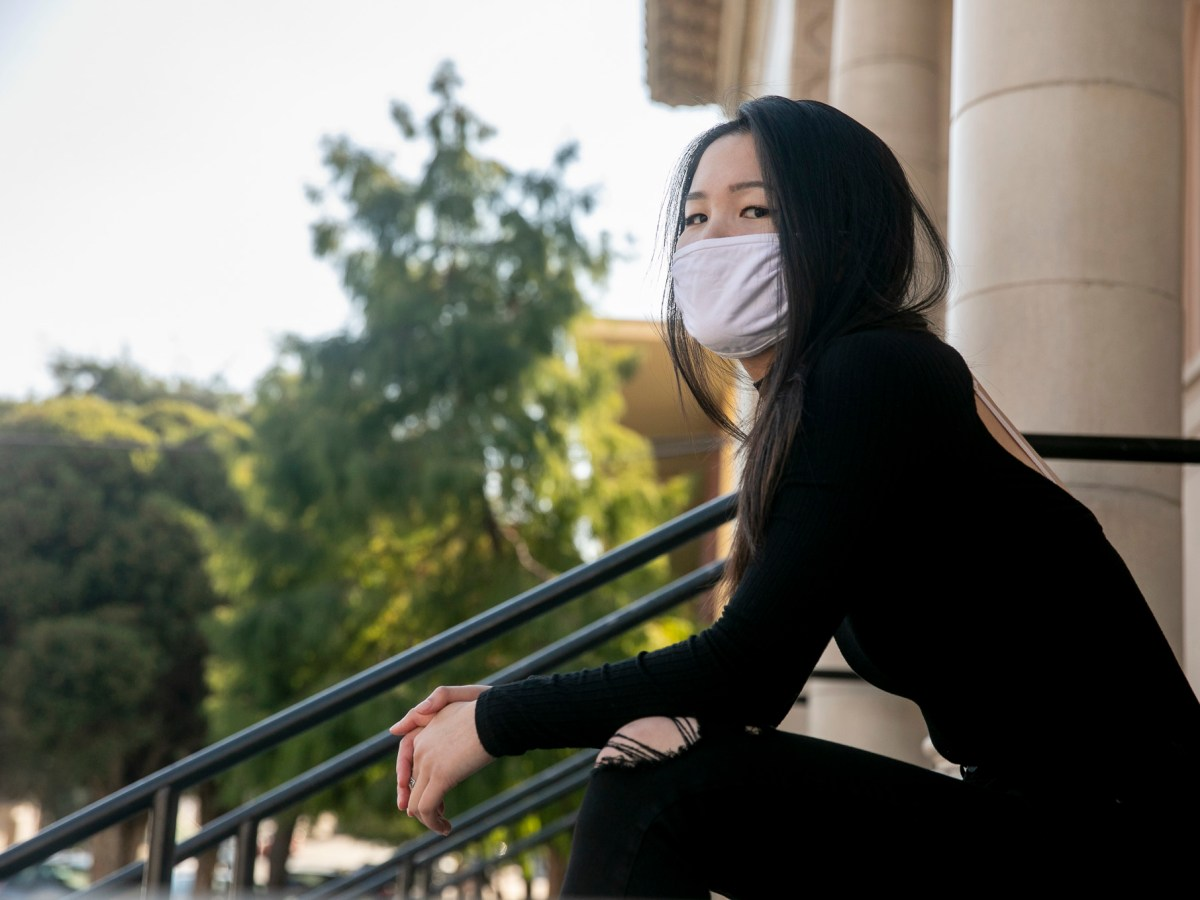Breanne Yee, 19, a third year student at Cal State Long Beach studying political science, sits for a portrait at the Sunset District library near her parents' home in San Francisco on Oct. 28, 2020. Yee, who grew up in the Sunset District, spent much of her childhood studying at the library and considers it almost like a second home. Photo by Anne Wernikoff for CalMatters