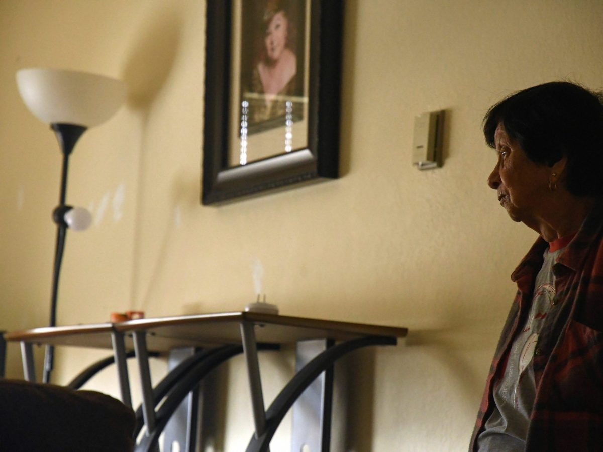A framed portrait of her sister hangs in Mary Martinez's living room on Aug. 7, 2020. Photo by Ayrton Ostly, The Salinas Californian