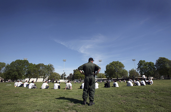 Wards from the sex offender treatment program exercise at the O.H. Close Youth Correctional Facility in Stockton on March 15, 2007. A controversial new law that takes effect next year will dismantle the state's current juvenile justice system and transfer responsibility for youth convicted of serious crimes back to counties. Photo by Steve Yeater, AP Photo