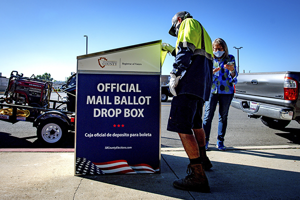 City of Redlands work crews install a ballot drop box in front of a Police Department building at the city's corporate yard on Thursday morning in Riverside on Thursday, Oct. 1, 2020. Secure boxes will be located across the county and are one way for voters to return their ballots. (Photo by Watchara Phomicinda, The Press-Enterprise/SCNG)