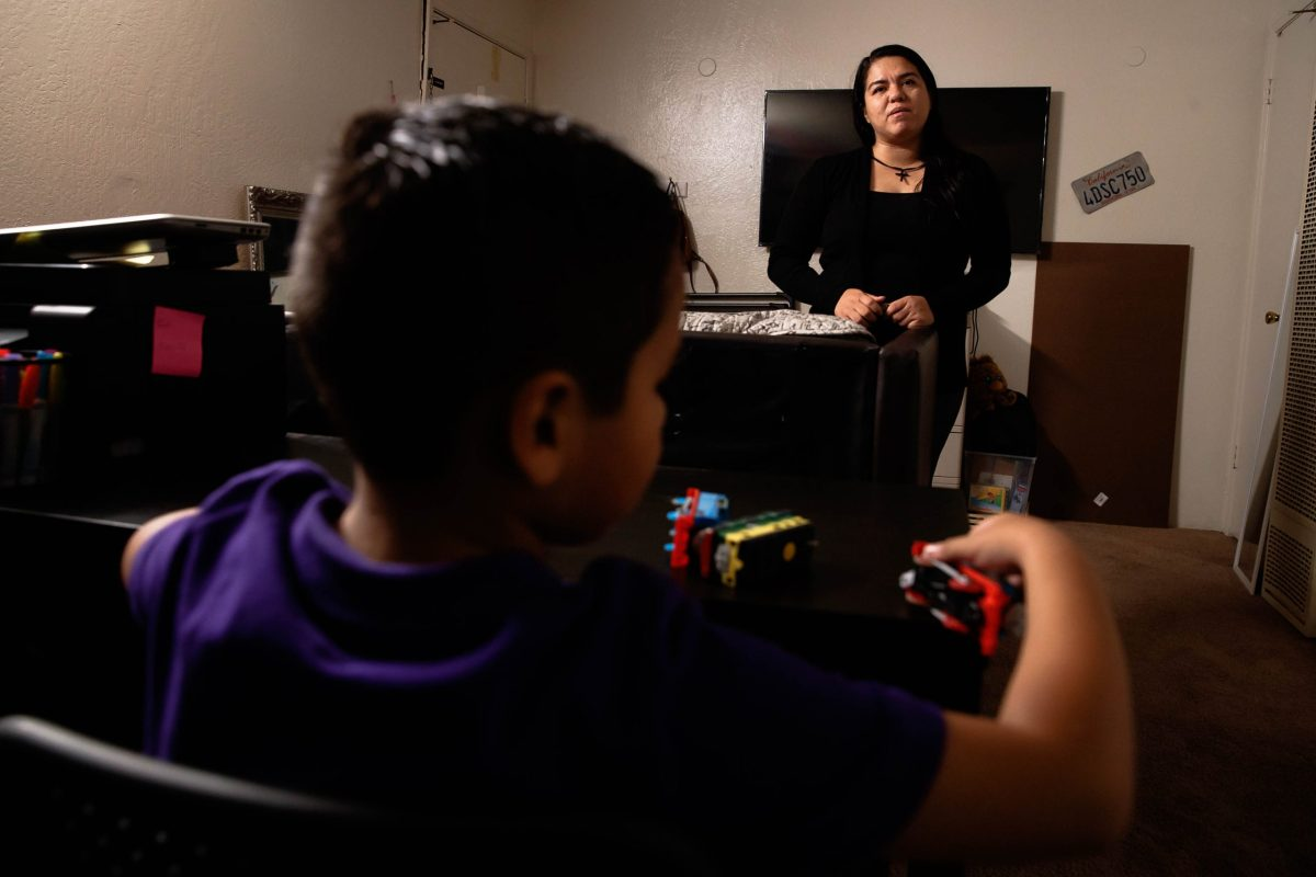 Alma Jimenez, right, stands in her living room as her son Abraham, 7, left, plays on a table at their home in Concord, Calif., on Wednesday, Sep. 30, 2020. Photo: Randy Vazquez/ Bay Area News Group
