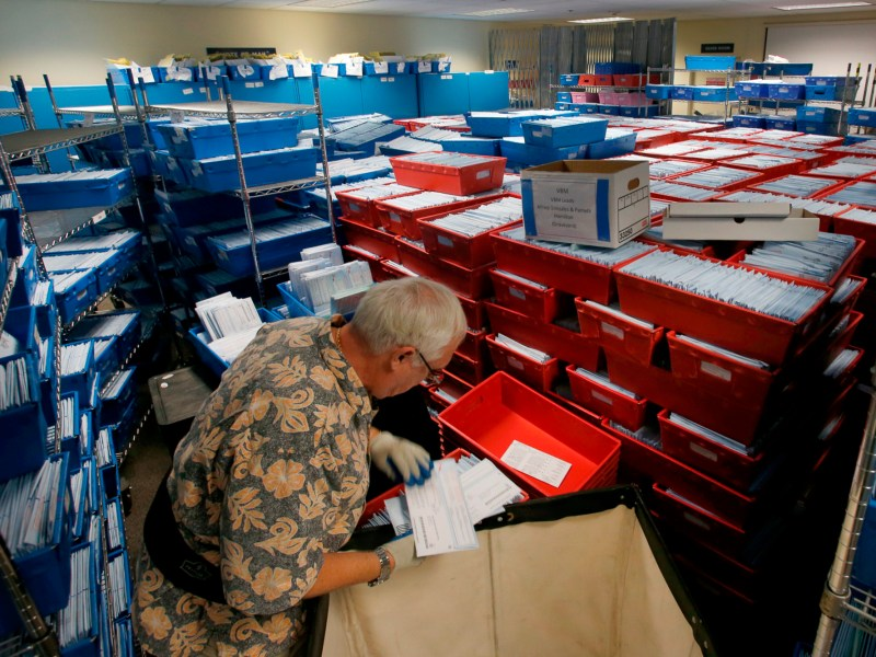 Santa Clara County elections worker Gary Capon processes provisional and late mail-in ballots on November 7, 2018, in San Jose. In 9 California counties, more people have already voted early than voted in total in 2016. Photo by Karl Mondon, Bay Area News Group