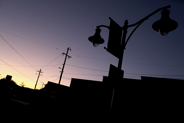 A street lamp is dark as a utility poles are seen in the background during a power outage in Sunol, on Oct. 10, 2019. Photo by Anda Chu, Bay Area News Group