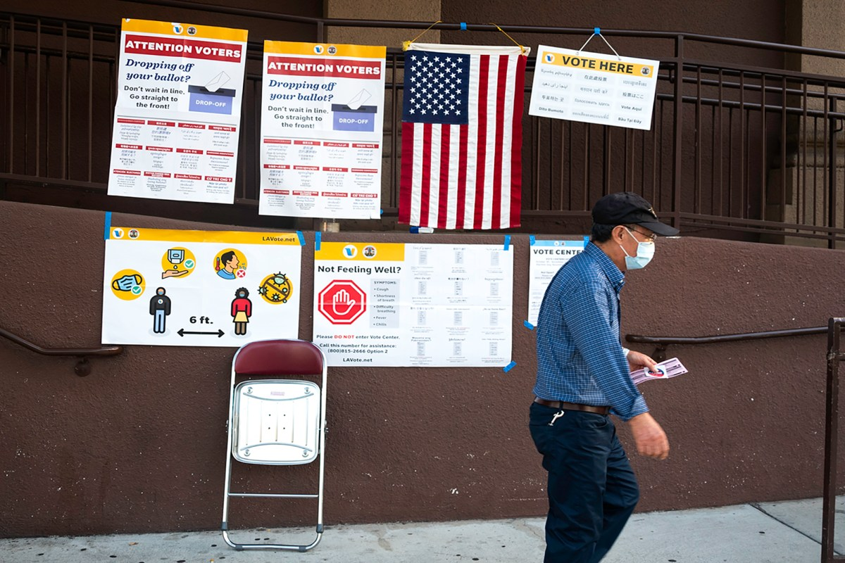 A voter exits a polling place in the West Adams neighborhood of Los Angeles on Nov. 3, 2020. Photo by Tash Kimmell for CalMatters.