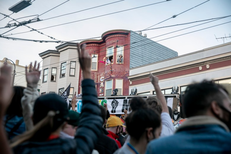 A large crowd dances and cheers on Castro street to celebrate Joe Biden and Kamala Harris winning the presidential election in San Francisco on Nov. 7, 2020. Photo by Anne Wernikoff for CalMatters