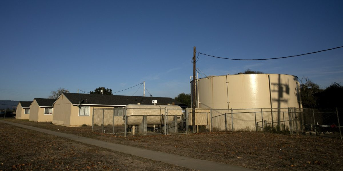 A water tank serving Buena Vista Migrant Center near Watsonville on Nov. 10, 2020. The tank stores water from a well that exceeds state guidelines for a chemical called PFOA by 3 parts per trillion--the state's new threshold is 10. Photo by Anne Wernikoff for CalMatters