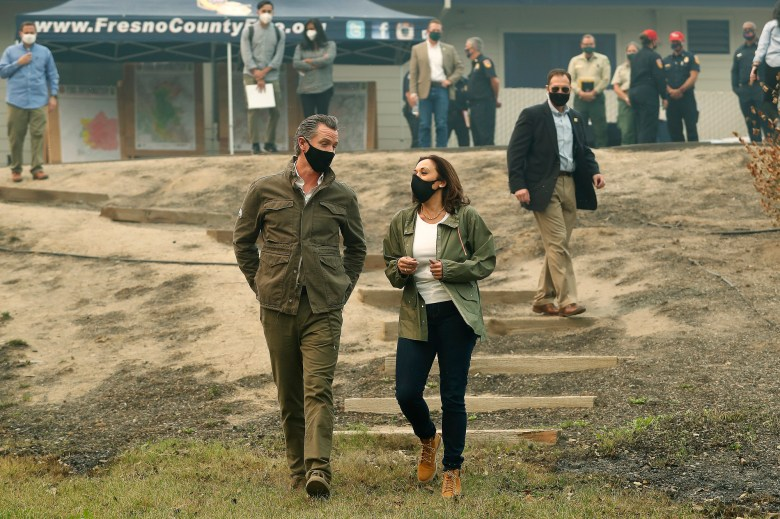 Gov. Gavin Newsom and Democratic vice presidential candidate Sen. Kamala Harris talk as they asses the damage during the Creek Fire at Pine Ridge Elementary on Sept. 15, 2020, in Auberry. Photo by Gary Kazanjian, AP Photo