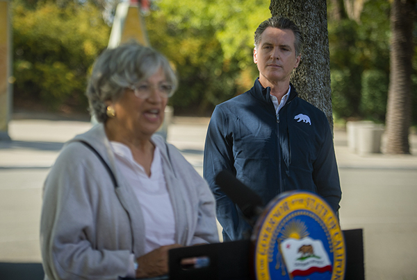 Gov. Gavin Newsom looks on as California Air Resources Board chair Mary Nichols, left, speaks at a press conference on Sept. 23, 2020, at Cal Expo in Sacramento, where Newsom announced an executive order requiring all new passenger vehicles sold in the state to be zero-emission by 2035. Photo by Daniel Kim, The Sacramento Bee via AP/Pool
