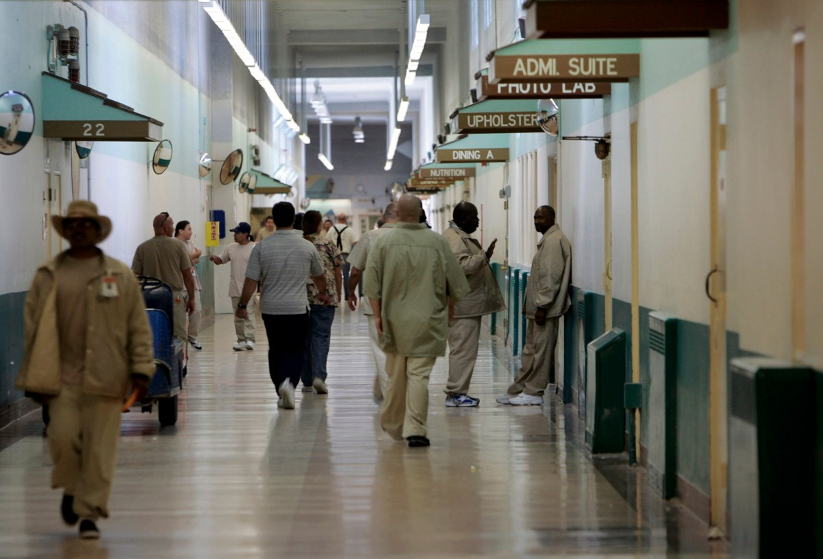 Patients at the Central Coast's Atascadero State Hospital walk the halls in 2006. Due to COVID, patients have at times been confined to their units, but still mingle in bathrooms, the dining hall and common day rooms. Of the state's psychiatric hospitals, Atascadero houses the largest number of mentally ill inmates from state prisons. Photo by Peggy Peattie, ZUMA Press, Inc. / Alamy Stock Photo