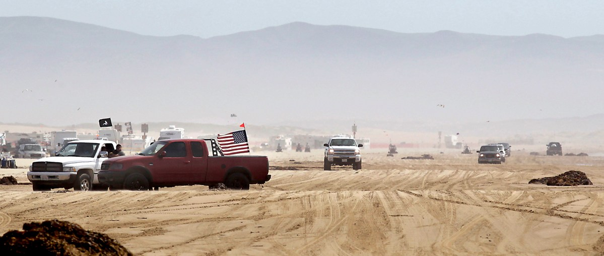 Trucks on the beach at Oceano Dunes National Vehicle Recreation Area on April 3, 2012. Oceano Dunes, three miles south of Pismo, is the only California State Park where vehicles may be driven on the beach. Photo by Felix Adamo / The Bakersfield Californian/ZUMAPRESS via Alamy