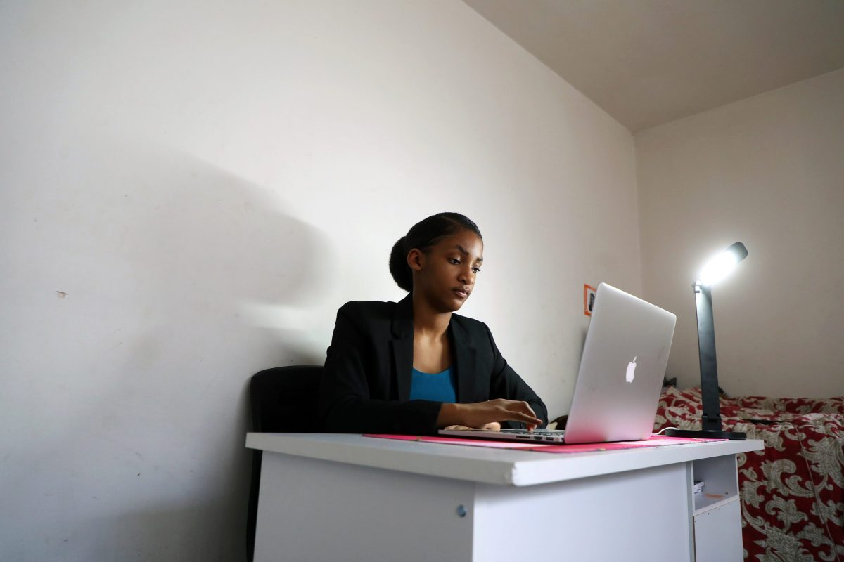 Oakland High School senior Mia Irvin-Pollard gets ready to start her work day as an intern for Okta Inc. from the apartment she shares with her grandmother on Wednesday, Nov. 18, 2020, in Oakland. Photo by Aric Crabb, Bay Area News Group