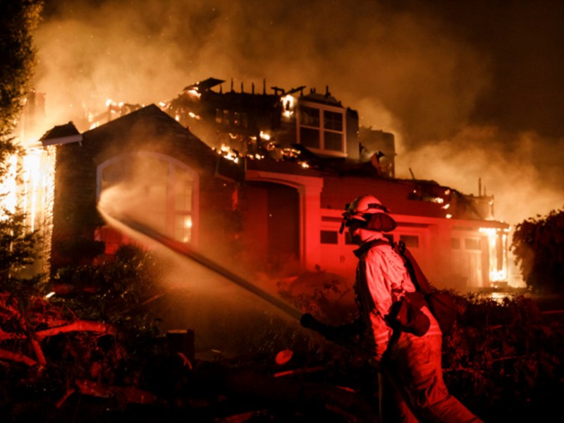 A firefighter hoses down a burning home to help stop the spread of the fire to nearby homes in the Skyhawk community as the Shady Fire burns in Santa Rosa, on Sept. 28, 2020. Photo by Dai Sugano, Bay Area News Group