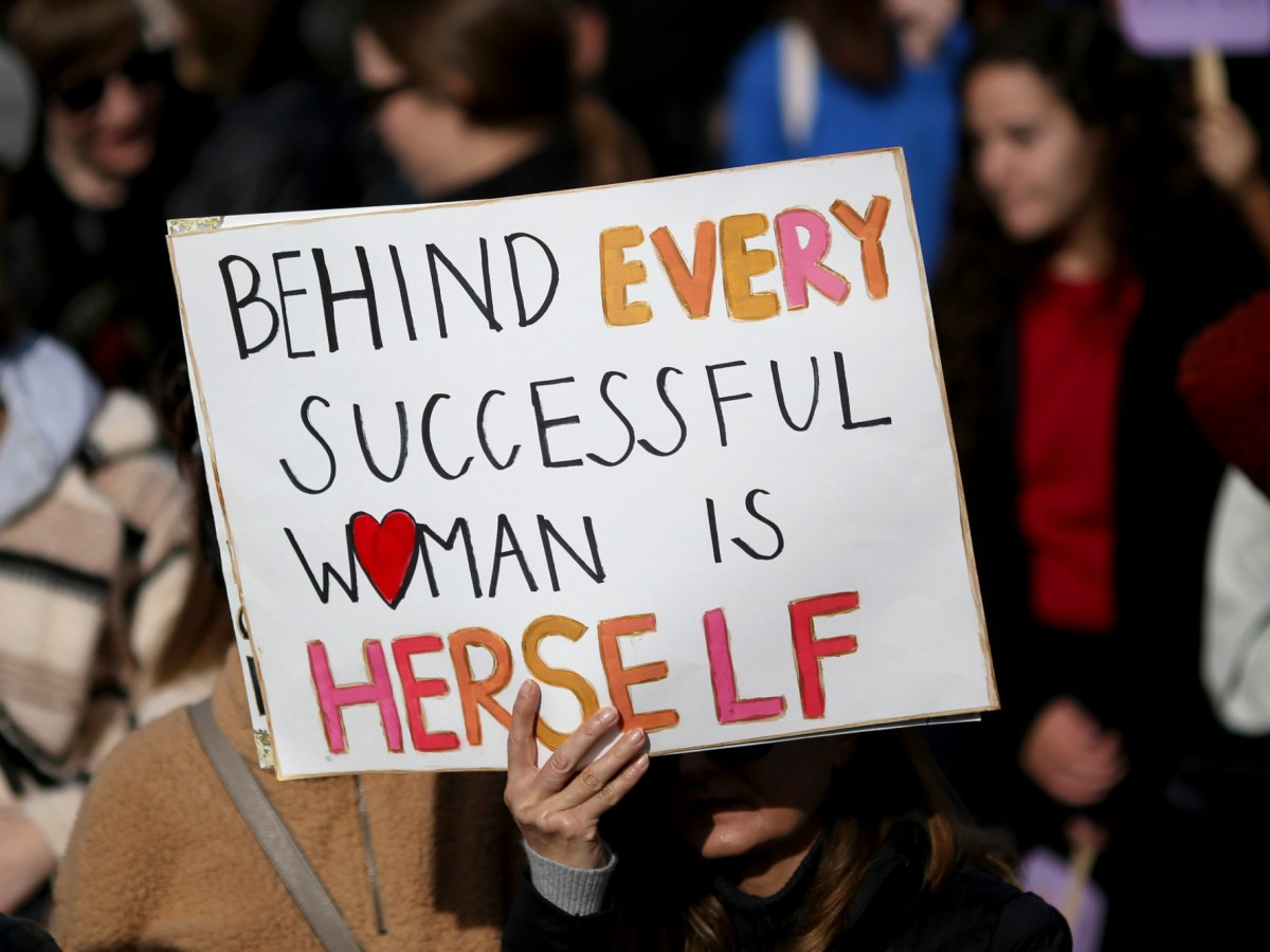A protester displays a sign during a rally at Arena Green during the Women's March San Jose on Jan. 18, 2020. Photo by Anda Chu, Bay Area News Group