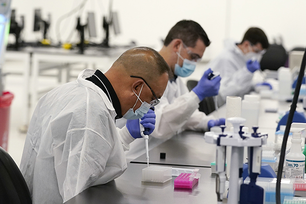 Technicians conduct COVID-19 tests at a new facility Friday, Oct. 30, 2020, in Valencia. Photo by Marcio Jose Sanchez, AP Photo/Pool