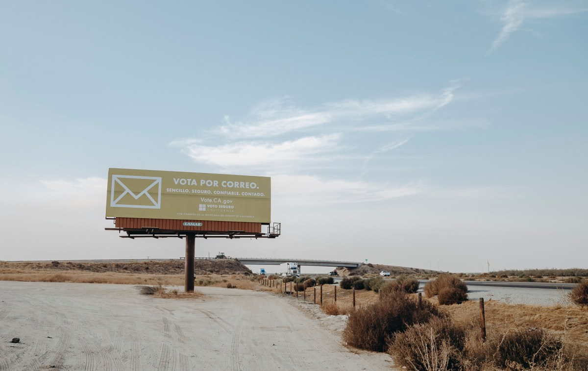 """Simple. Secure. Trustworthy. Counted."" A sign reads in Spanish encouraging voters to vote by mail Off I-5 on November 3, 2020. Photo by Clara Mokri for CalMatters"