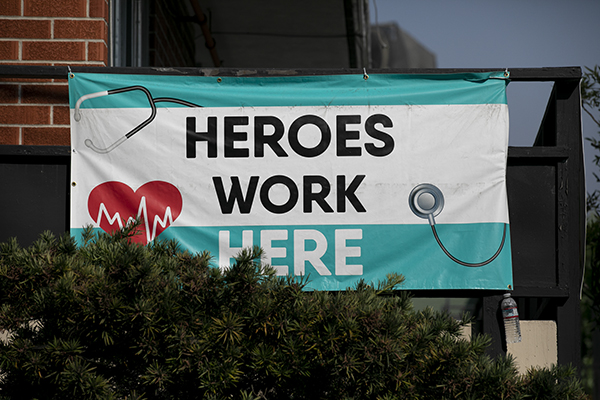 A 'heroes work here' sign hangs outside of a building downtown Oakland on August 24, 2020. Photo by Anne Wernikoff for CalMatters