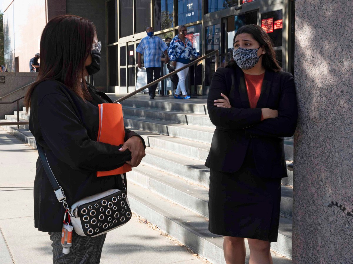 Attorney, Nathaly Medina speaks with client, Lynn Byers before her hearing at the Stanley Mosk courthouse in down town Los Angeles, on Dec. 2, 2020. Photo by Tash Kimmell for CalMatters