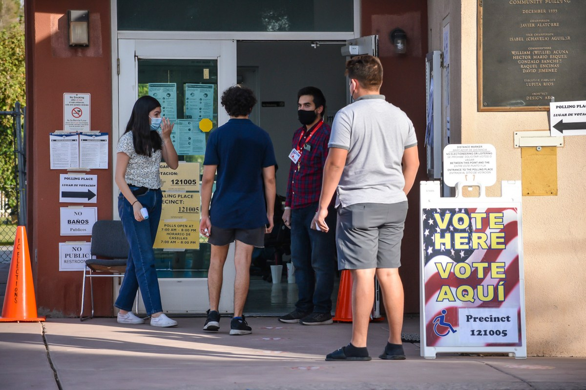 Poll workers and members of the public can be seen near the entrance to the polling site at the Mario Esquer Building in Calexico on Nov. 3, 2020. Photo by CORISSA IBARRA, Calexico Chronicle (CM use only)