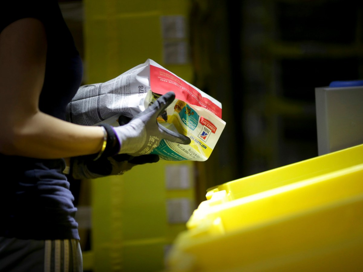 A worker sorts an item at an Amazon fulfillment center in Sacramento on Aug. 28, 2019. Today, Attorney General Xavier Becerra filed a complaint against Amazon alleging the online shopping giant isn't complying with workplace safety investigators. Photo by Anda Chu, Bay Area News Group