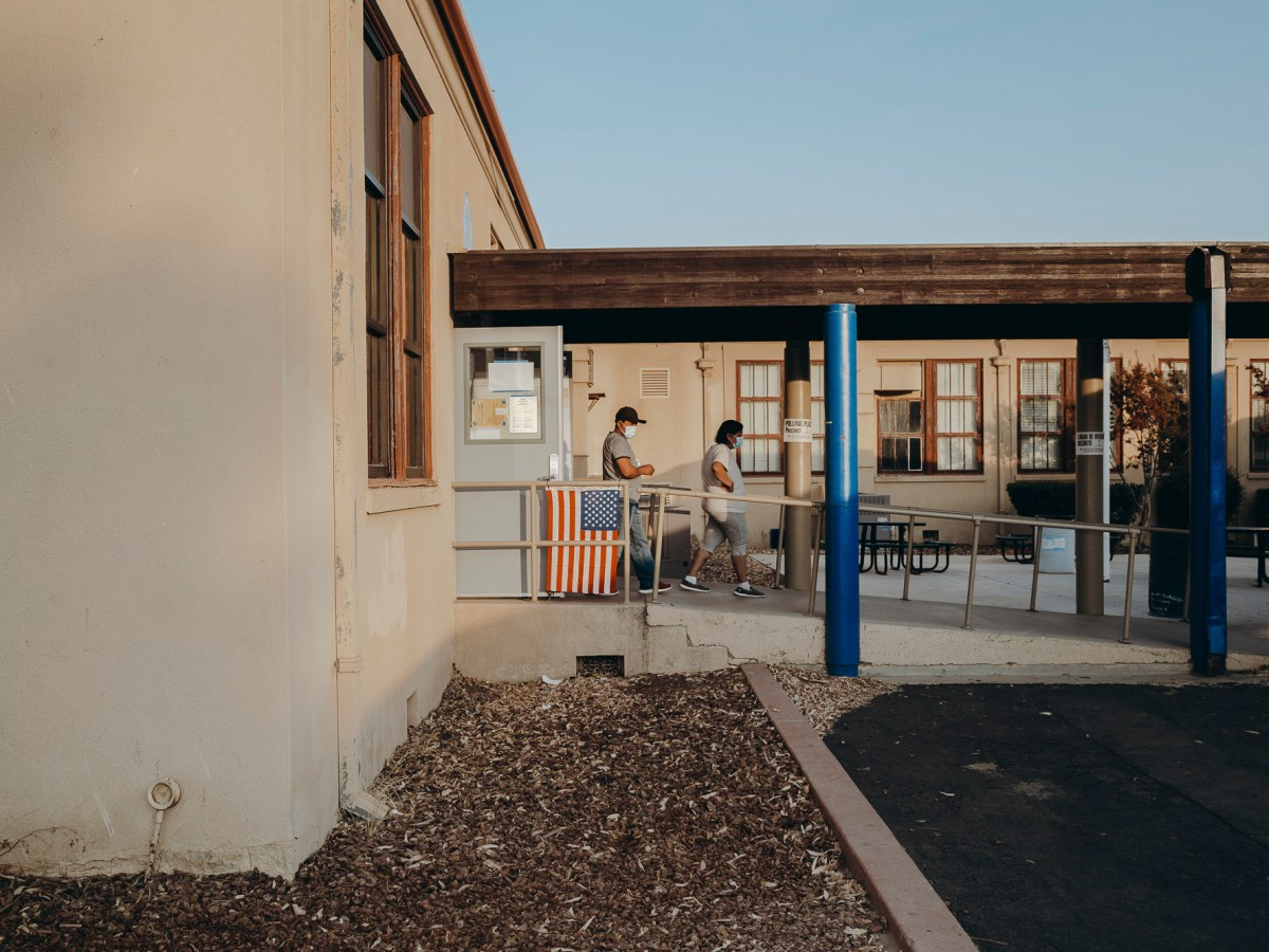 Voters exit Avenal High School in Kings County on November 3, 2020. Photo by Clara Mokri for CalMatters