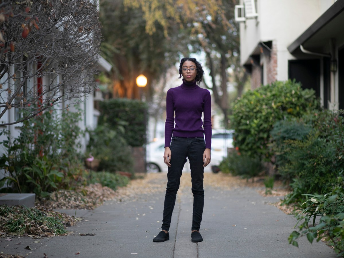 Maya Brady in her Sacramento apartment she shares with her partner on Dec. 3, 2020. Photo by Anne Wernikoff, CalMatters