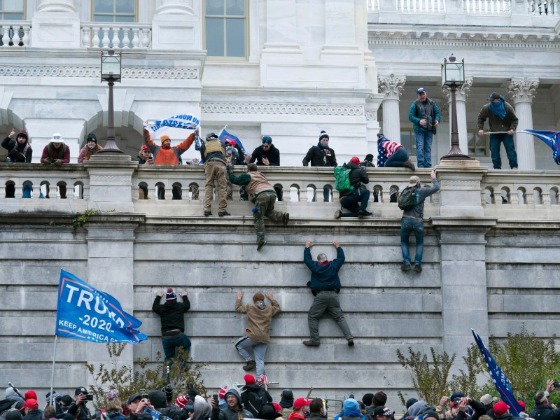 A mob of Trump Supporters climb the west wall of the the U.S. Capitol on Jan. 6, 2021, in Washington. Photo by Jose Luis Magana, AP Photo