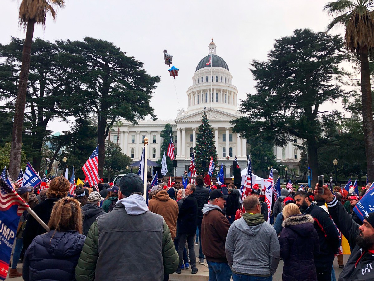 Hundreds of pro-Trump demonstraors gather outside the California Capitol in Sacramento, Jan. 6, 2021. In anticipation of violence protests this coming week, Gov. Newsom has ordered the National Guard to deploy at the Capitol. Photo by Adam Beam, AP Photo