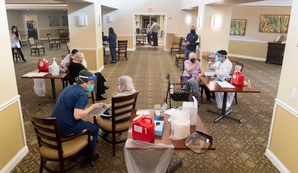 Residents get the Pfizer/BioNTech COVID-19 vaccine at the Emerald Court senior living community in Anaheim on January 8, 2021. COVID vaccines will not be made available to anyone 65 and over. Photo by Paul Bersebach, Orange County Register/SCNG
