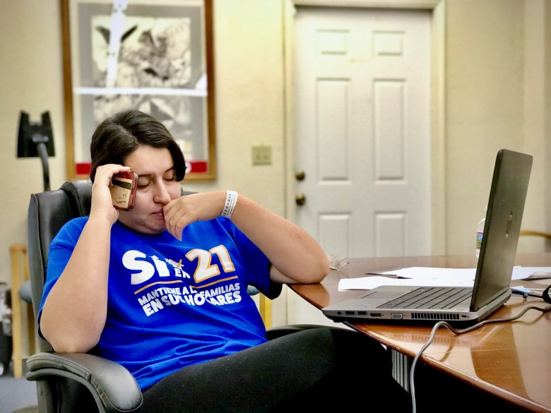 Selena Aguilera, a resident of Poplar in Tulare County, a volunteer for the Central Valley Empowerment Alliance, talks on her cell phone in October urging support for Proposition 21. Aguilera registered to vote for the first time in October. Photo courtesy of Arturo Rodriguez