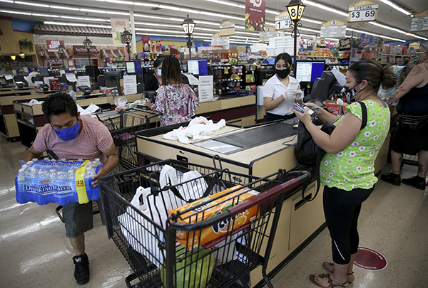 People check out at the Cardenas Markets grocery store on High Street in Oakland on May 27, 2020. Photo by Jane Tyska, Bay Area News Group