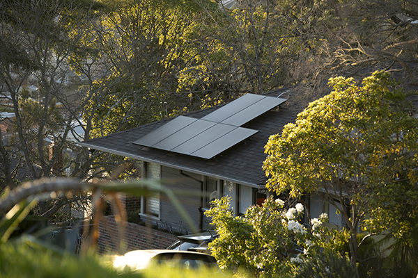Rooftop solar panels on a home in the Rockridge neighborhood of Oakland. Photo by Anne Wernikoff, CalMatters