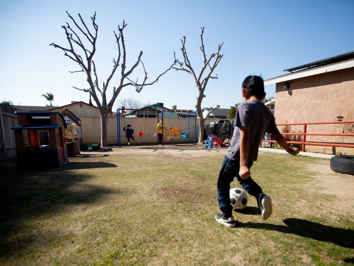 Children play in the backyard of Ana Ballesteros home where she runs a day care in Delano on Feb. 26, 2021. Photo by Shae Hammond for CalMatters