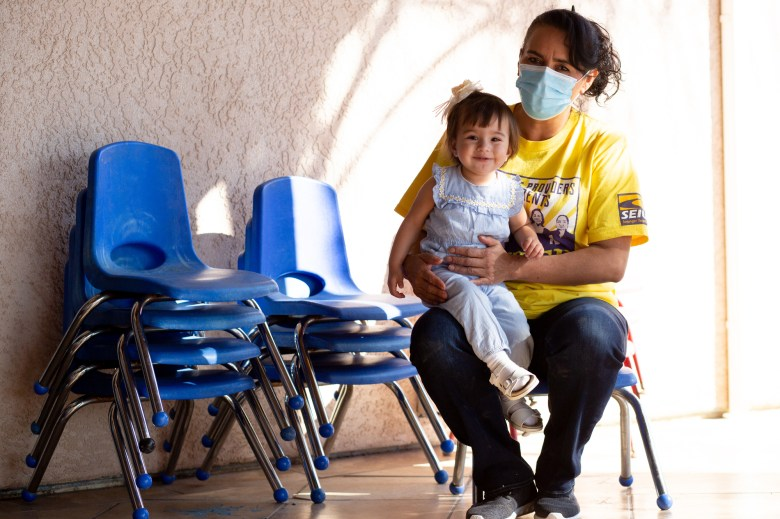 Ana Ballesteros sits for a portrait with her grand daughter Ava Dominguez at Ana's Family Child Care in Delano on Feb. 26, 2021. Photo by Shae Hammond for CalMatters