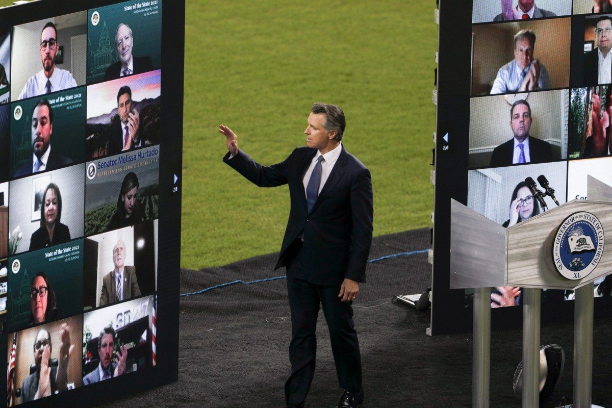 Gov. Newsom waves to virtual guests during the State of the State address at Dodger Stadium on March 9, 2021. Photo by Shae Hammond for CalMatters