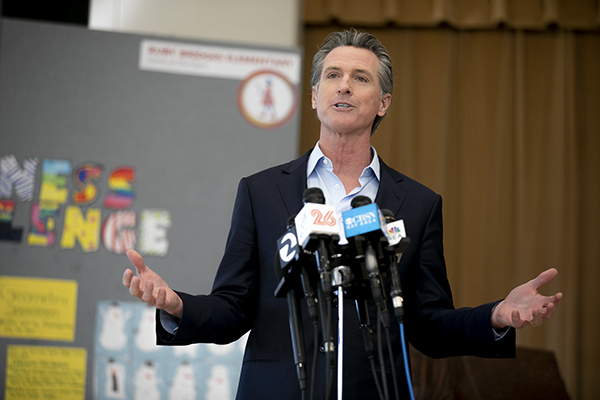 "Gov. Gavin Newsom speaks to the press during a visit to Ruby Bridges Elementary School in Alameda on March 16, 2021. ""We will fight it. We will defeat it,"" Newsom said of the recall effort. Photo by Anne Wernikoff, CalMatters"