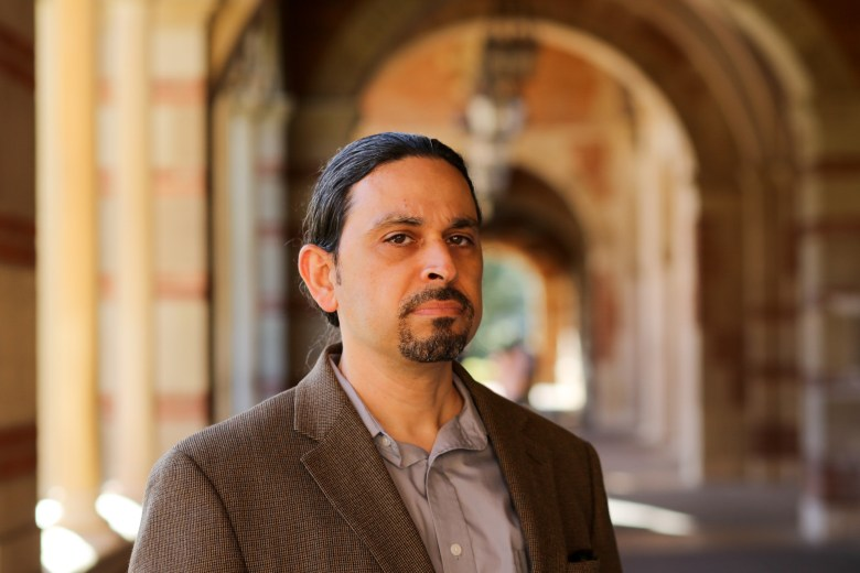 Michael Calderon-Zaks stands for a portrait at UCLA in Brentwood on March 20, 2021. Michael is an adjunct professor of sociology at UCSD and formally at UCLA. Photo by Shae Hammond for CalMatters