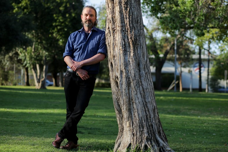 David Walter stands for a portrait at Encino Park in Encino on March 23, 2021. David is an adjunct professor at UC Berkeley lecturing on humanities and creative writing. Photo by Shae Hammond for CalMatters