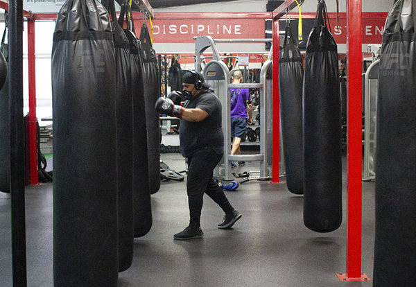 UFC Gym Long Beach members train indoors for the first time in months as Los Angeles County moves into the less restrictive red tier March 15, 2021. Photo by Hunter Lee, Press-Telegram/SCNG